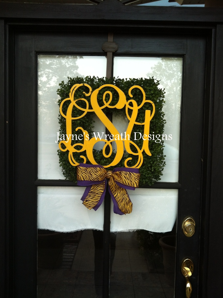 Square boxwood wreath with LSU monogram letters and purple and gold tiger stripe bow