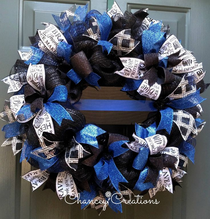 Thin Blue Line Wreath, Police Gift, Front Door Wreath, Law Enforcement Wreath, Deco Mesh Wreath Show your support for Law Enforcement with this Thin Blue Line Wreath. Constructed on a wire wreath frame with two different types of Poly Deco Mesh: Metallic Black and Metallic Navy/Royal. Four different coordinating patters of wire ribbon are layered throughout this handcrafted wreath. A high gloss, aluminum, Thin Blue Line sign is positioned at the center. National Peace Officers Memorial...