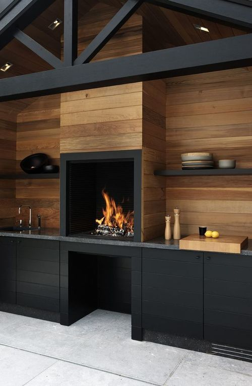 Sleek modern feel using natural mediums of wood and fire