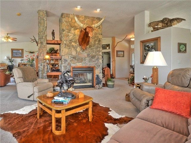 $850,000. High ceilings in living room. Double sided propane fireplace.