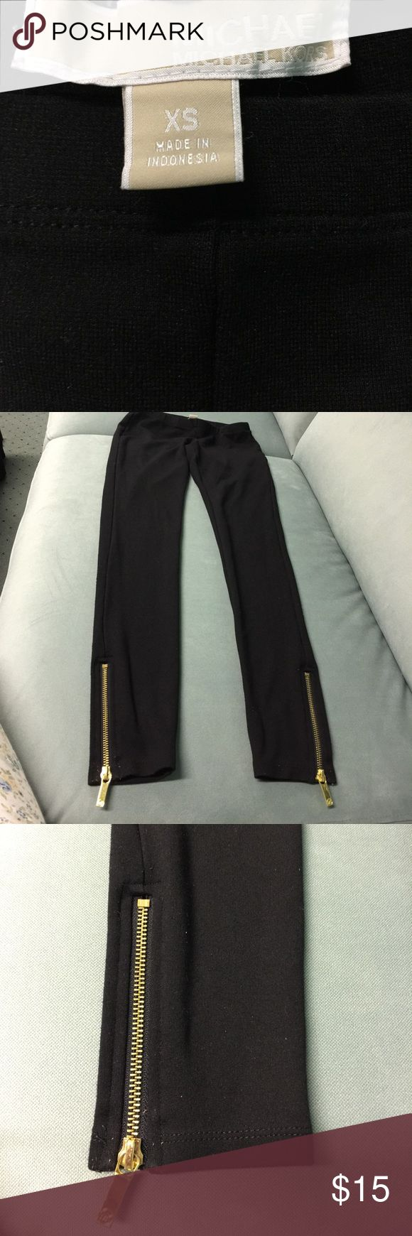 MICHAEL BY MICHAEL KORS  ZIPPERED ANKLE LEGGINGS Great pair of stretch leggings in black with gold zipper ankles with MK LOGO on zipper. In good condition ❤️ Size XS MICHAEL Michael Kors Pants Leggings