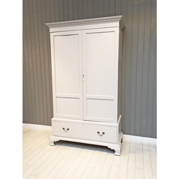This mahogany wardrobe dates back to the early 1900s and has been painted in Little Greene's 'French Grey' for a contemporary feel. There is a double hanging section and a drawer at the bottom for further storage. The door has a working lock and key.  H210 x W122 (at widest) x D53