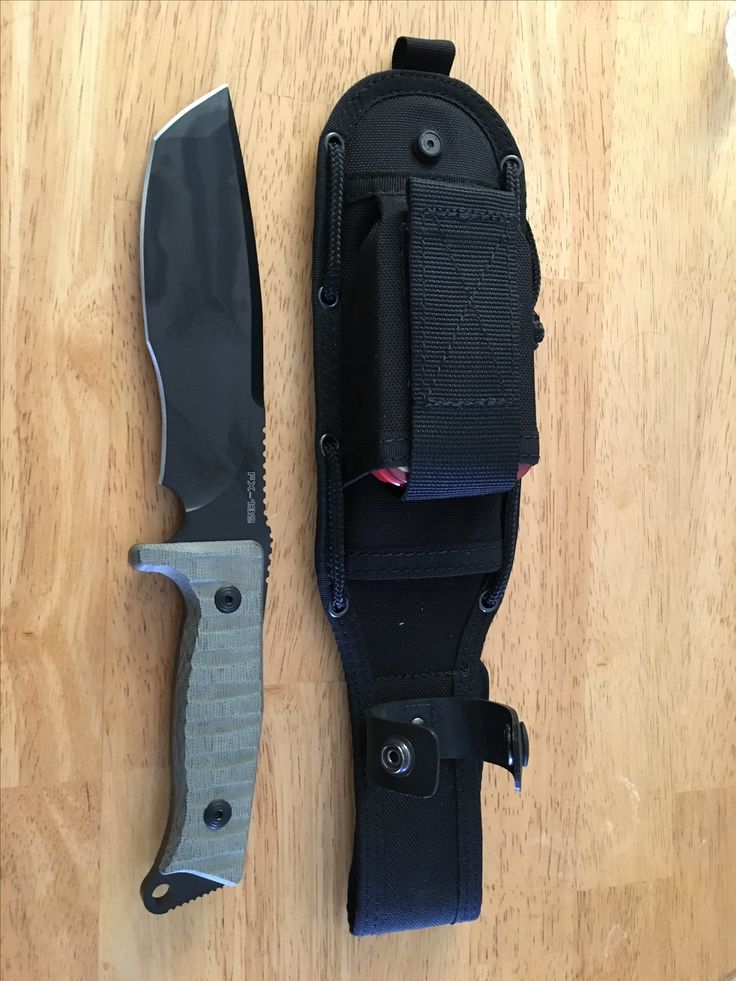 Fox Trapper knife. The sheath has a pocket big enough for a survival tin also. It's a great survival knife.