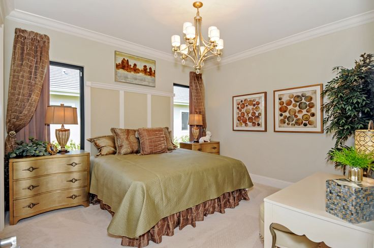 KVS Interior Design has brought a traditional classic style to Stock's Regency Manor model. The home's color palette includes soft creams, golds and silvers with chocolate brown accents. Heavy textures and embroidered accents on the fabrics are mixed with walnut-toned furnishings and various metals. Travertine flooring is found throughout the home.