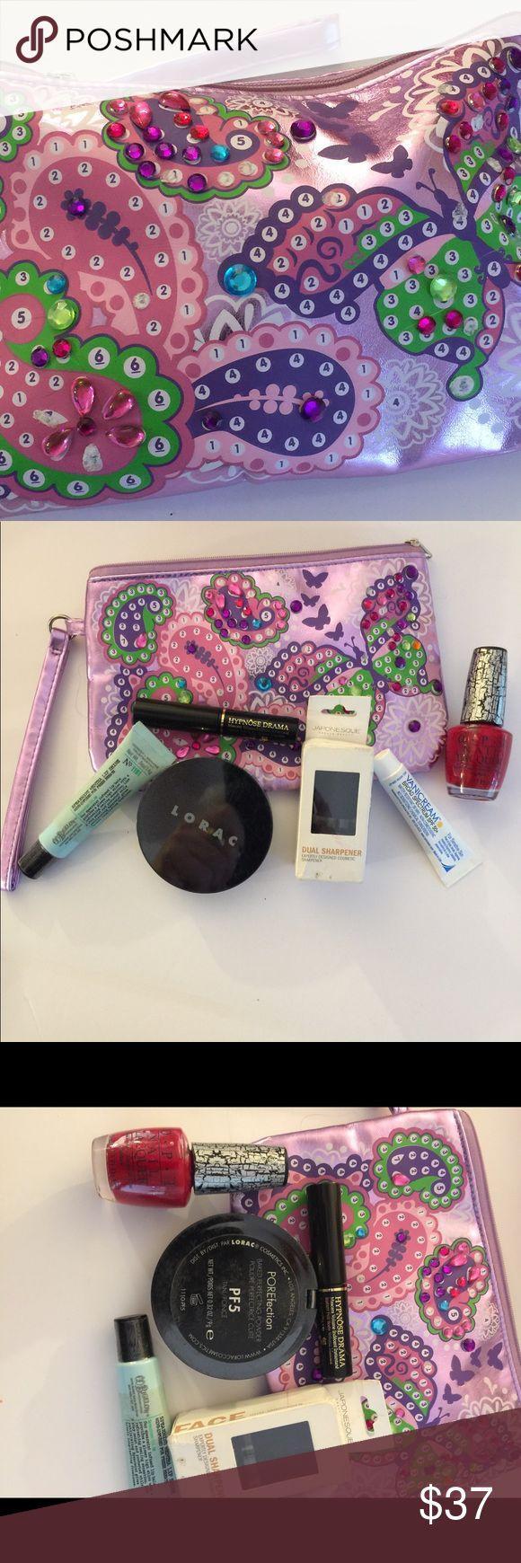 Bargain bundle make up bag filled! Bigelow spearmint lip shine, Lorac porfection Pfs, (used slightly :not my shade ),Japonesque dual sharpener,OPI red crackle polish,vanicreme,Lancôme Hypnos Drama black mascara ... many Makeup