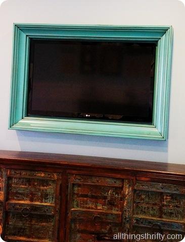Love the frame around the TV.