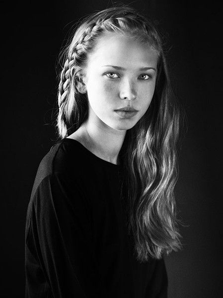 black/white photograph of young girl with braided hair.