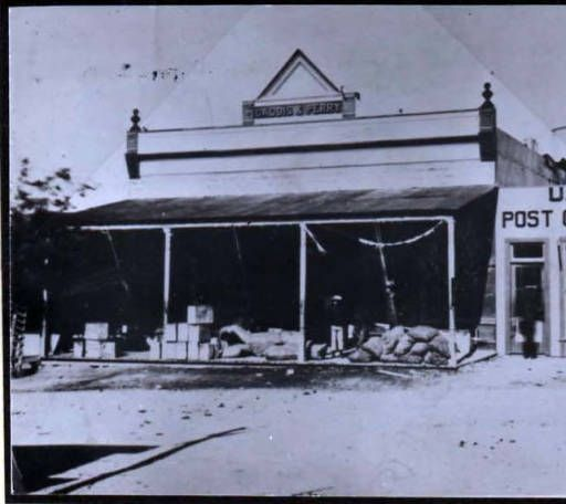 This photo is of the first post office building in Kingman, which is now known as the Great Western Bank Building