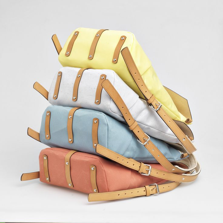 TheBétaVersion Ezra rucksacks in pastel yellow, grey marled, turquoise and rust canvas combinced with vegetable tanned leather - all backpacks come with a built in felt laptop case.