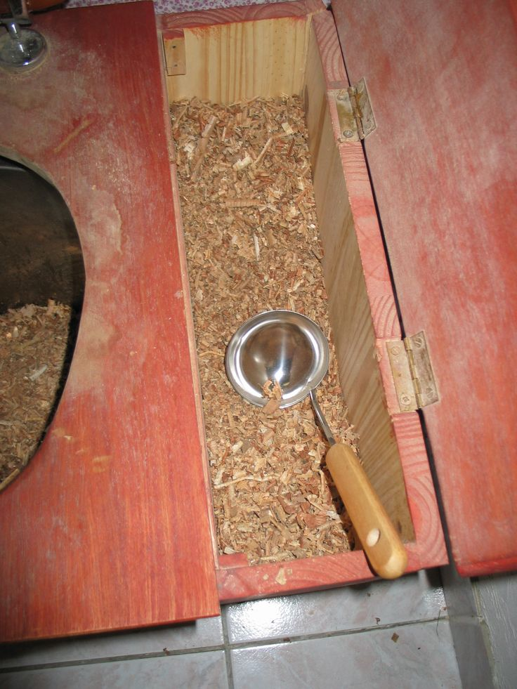 composting toilet  sawdust compartment