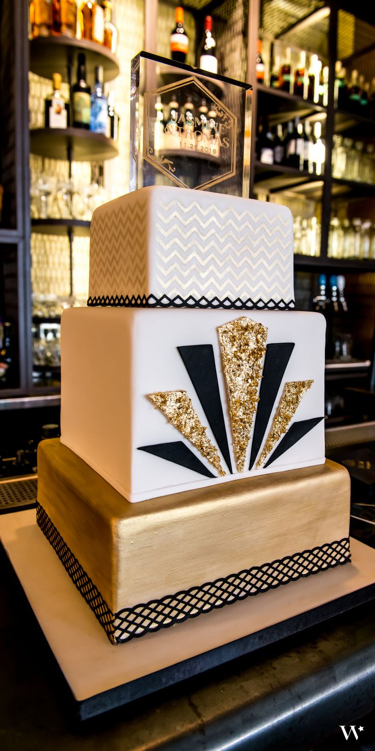 Glam black and gold cake - from our Art Deco inspired wedding! Shop the whole look here: http://www.weddingstar.com/theme/art-deco