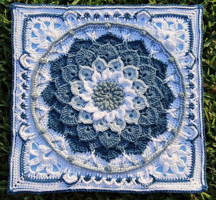 Blue Enchanted Garden. The center (round part) is the Crocodile Flower and the outer part is Sophie's Universe (both on Ravelry).TLR