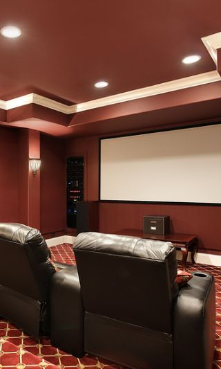 Ruby Red Designed Home Theater With Stadium Seating And Brown