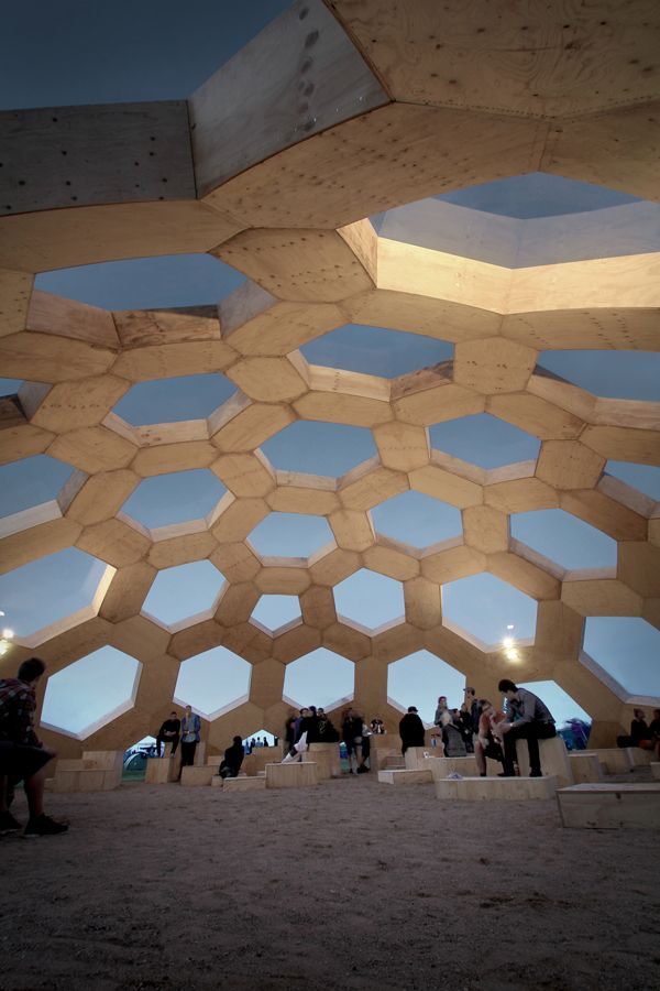 geodesic dome,  a construction that optimises the use of resources to a high degree, by imitating natures own methods.  The molecular structure found in one given family of carbon molecules, is copied when constructing geodesic domes. This structure allows for great strength and stability, construction of large-sized