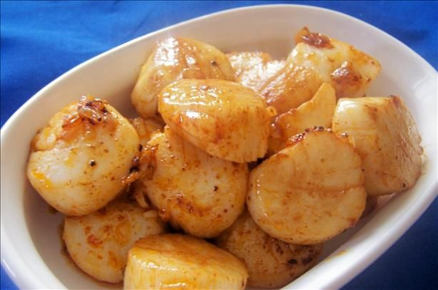 1 lb scallops   1 tablespoon olive oil   2 cloves crushed garlic   1 finely chopped shallot   1 teaspoon paprika   Directions:  1heat saute pan, add oil.2saute garlic and shallot until tender.3add scallops sprinkle with paprika.4cook over med heat approx 15 min (depending on size of scallops) turn mid way.5Enjoy!    nom nom