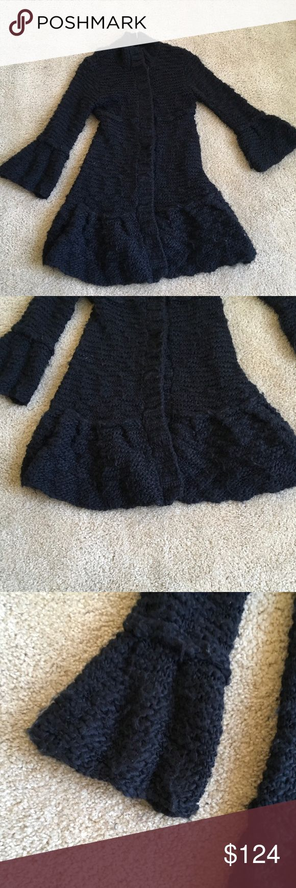 """FREE PEOPLE LONG BLACK Sweater Coat Jacket COMFY S FRE PEOPLE BLACK knitted wool fabulous long sweater jacket coat. Huge snaps 4 closure. bell sleeves & knitted ruffle bottom make this the PERFECT GO TO JACKET ANYTIME. SMALL 16"""" across chest 36"""" long.FREE PROPLE WOOL sheds some.... Free People Sweaters"""