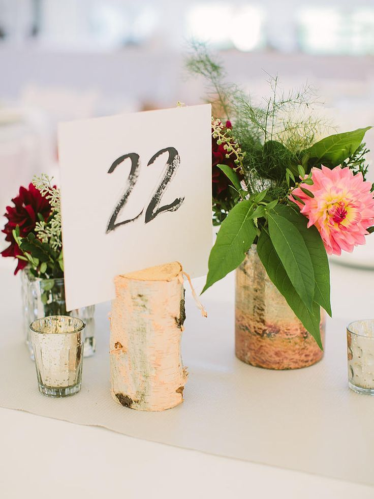 These DIY natural birchwood stands for table numbers are a must have for any rustic, fall wedding.