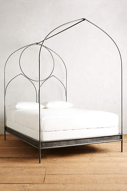 Ariadne Bed - anthropologie.com  Modeled after the pointed arches of medieval architecture, this iron frame aligns gothic shapes with modern practicality. We find it pairs nicely with eclectic pieces for a collected look.