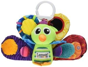 Tomy Lamaze Play and Grow Take Along Toy, Jacques the Peacock While a lot of toys seem to fall out of the car seat once baby starts playing with them, the flatness of the feather panels and the flat bottom of the peacock body seem to help this toy stay in the seat. http://awsomegadgetsandtoysforgirlsandboys.com/easter-gifts-for-baby/ Easter Gifts For Baby: Tomy Lamaze Play and Grow Take Along Toy, Jacques the Peacock