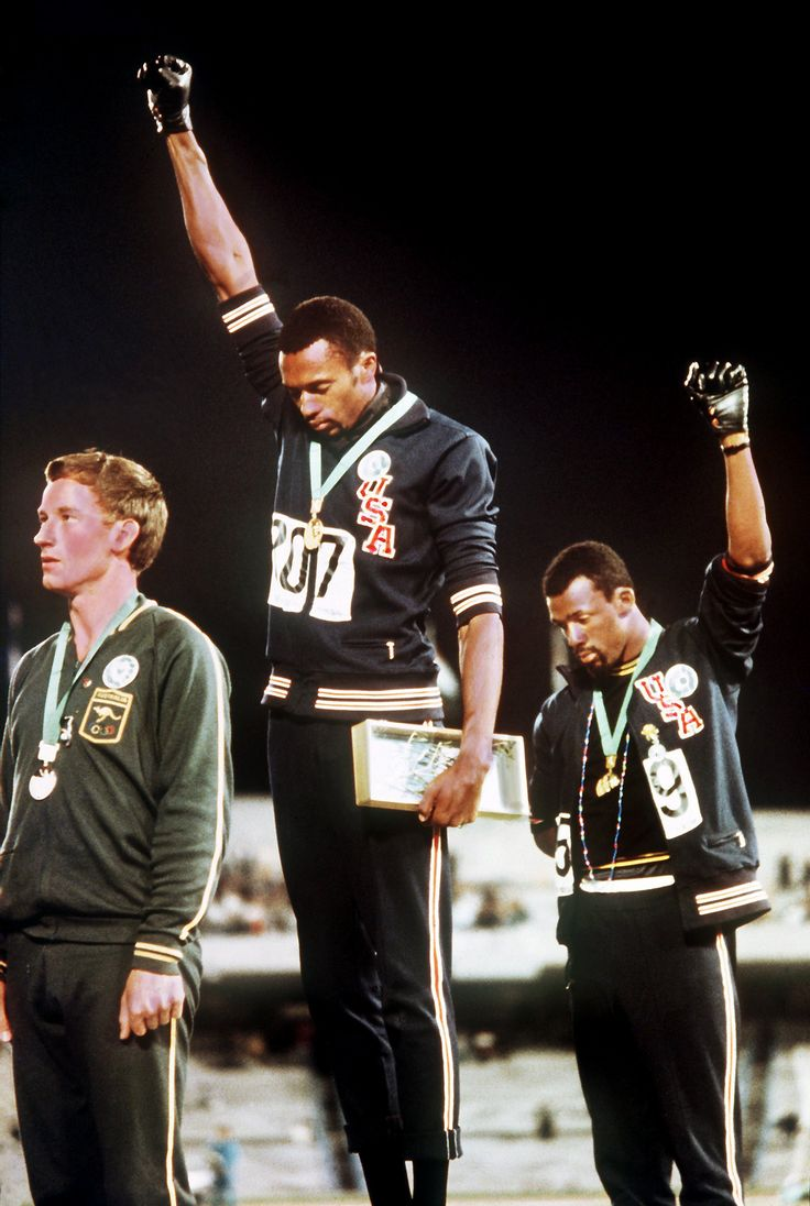 (1968) Gold medalist Tommie Smith and bronze medalist John Carlos showing the raised fist on the podium after the 200m race at the 1968 Summer Olympics; both wear Olympic Project for Human Rights badges. Peter Norman also wears an OPHR badge in solidarity  - Imgur