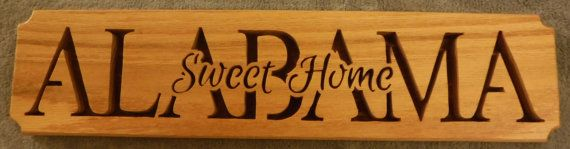 """Plaque is hand cut out of 1/2"""" thick red oak lumber.   Features 1/8"""" baltic birch backer.  Front of backer is stained red oak.   Edges are rounded.    Sprayed with a clear finish.  3 3/4"""" wide by 16"""" long.       Shipping is calculated depending on your zip code.    Does not include any hanging hardware, back is open to match background plaque is placed. 