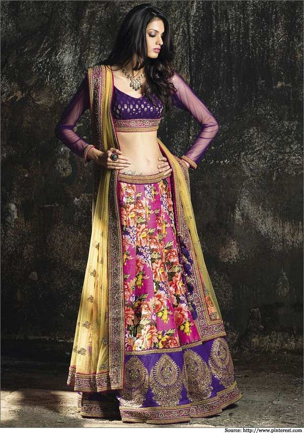 The full sleeved net choli blouse of royal purple blends well with this lehenga.  #bridallehengas #weddinglehengas
