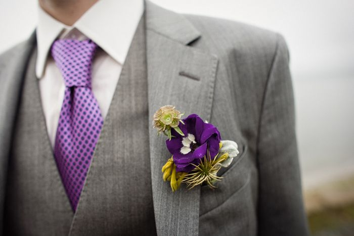 purple tie and purple flower looks pretty on gray suit