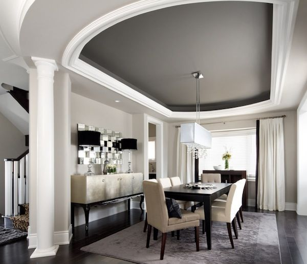 Love this dining room with the dark grey painted tray ceiling! Great buffet with lamps that compliment the chandelier!
