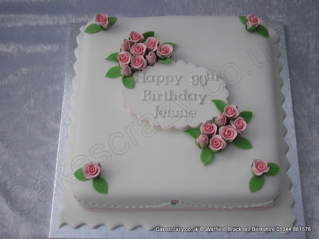 Traditional style square celebration cake with pink sugar ...