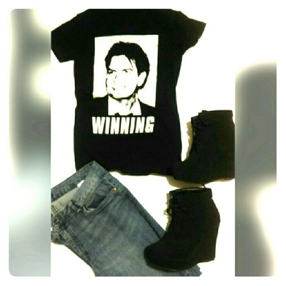 """Charlie Sheen """"Winning"""" Tshirt Short sleeve black T-shirt with a printed image of Charlie Sheen. Underneath Charlie Sheen says 'Winning'. Not faded, or dull. Soft and comfortable.  No size tags on item but it is a SMALL. Tops"""