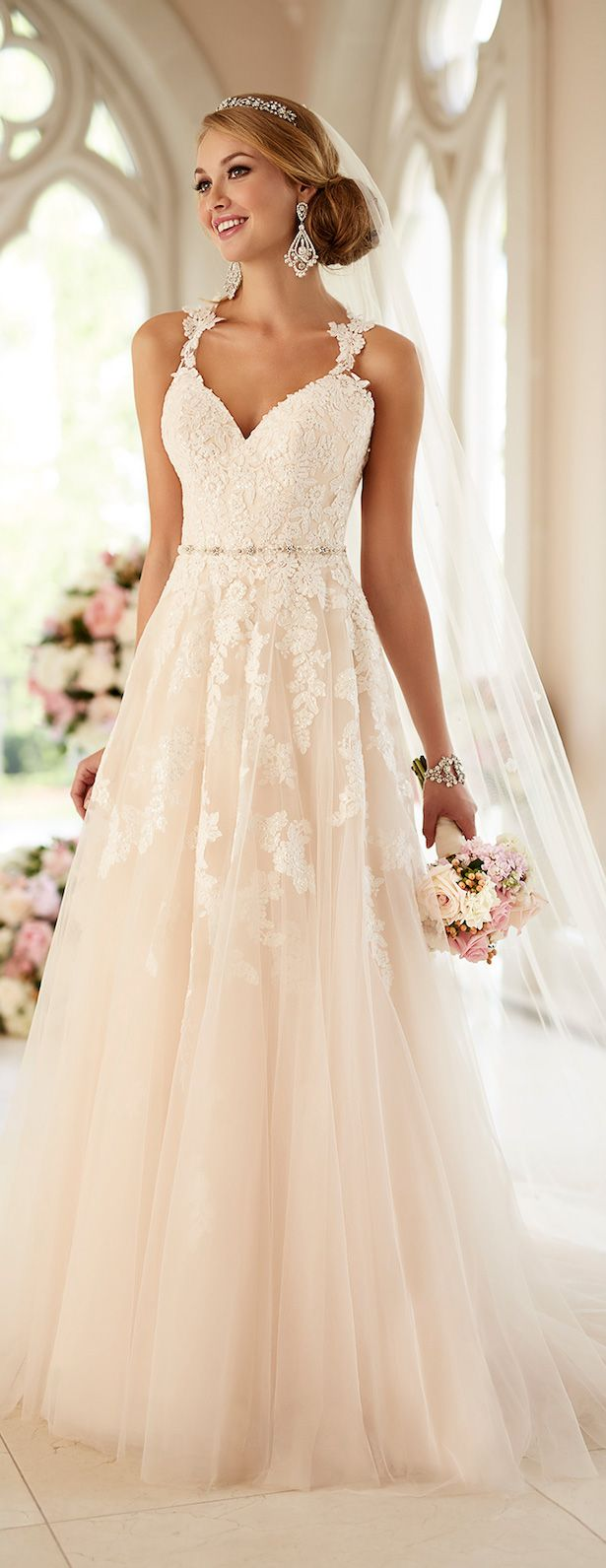 Walk down the aisle in this beautiful lace dress with the perfect amount of detail. #springwedding