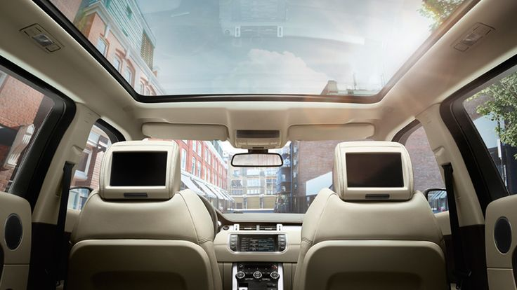 Enjoy the light and airy cabin when you include a panoramic roof ~ Oooh!!! #2014 #RangeRover #Evoque