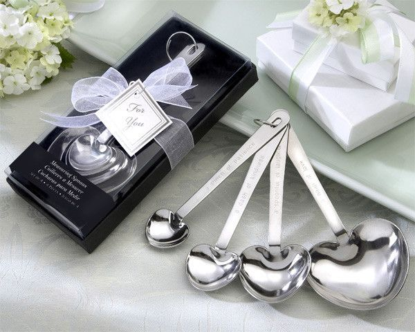 """""""Love Beyond Measure""""  Heart-Shaped Measuring Spoons in Gift Box. Description Love is like cooking. When you combine the right ingredients, the result is heavenly! These pretty and practical heart-shaped measuring spoons will give your guests all they need to cook with love. Each set of four spoons features """"measures of love"""" on one side with traditional measurements on the other. """"A Pinch of Patience"""" = 1/4 teaspoon, """"A Dash of Kindness"""" = 1/2 teaspoon, """"A Spoonful of Laughter"""" = one…"""