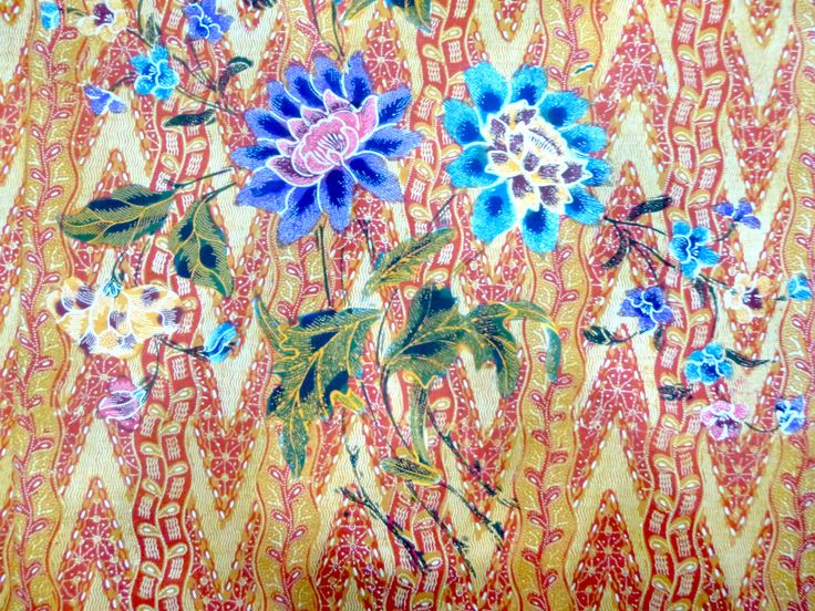 Medung prints as background with pop coloured flowers.