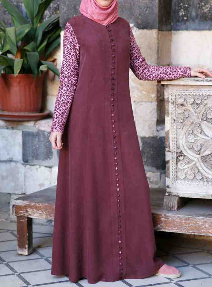 Embroidered Sleeves Gown Burgundy color You're going to fall head over heels in love with this delicately detailed gown. The intricate geometric floral motif on the sleeves, flattering princess seams, and flared skirt combine to create an elegant and exquisite look. The faux buttons add style and a picture-perfect finishing touch.
