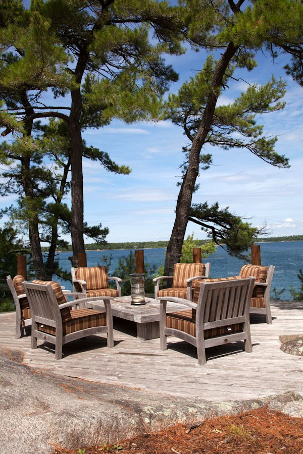 outdoor decor cottage deck #Muskoka #sundaycrush Love how the deck melts into the natural rock.  Even the same colors.  Awesome