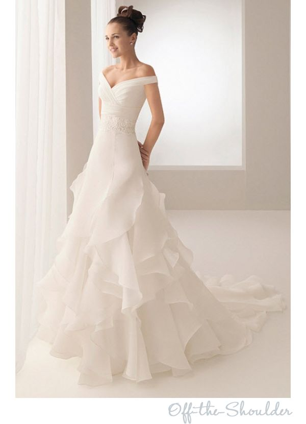 Off the shoulder wedding dress. I actually kind of like this...