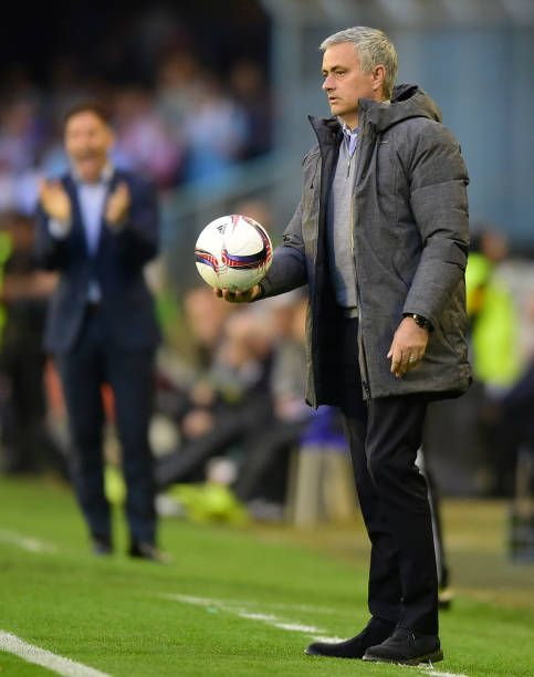 Manchester United's Portuguese coach Jose Mourinho holds the ball on the sideline during their UEFA Europa League semi final first leg football match...