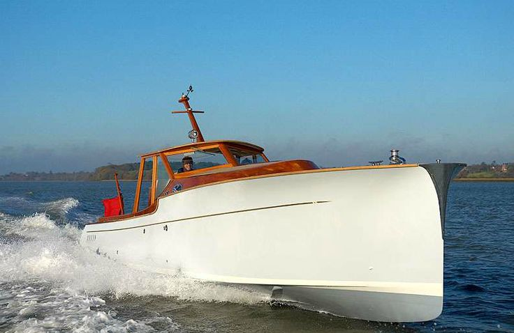 """The P40 by Spirit Yachts is, and I say this without reservation, one of the most beautiful production boats in the world. The 40 foot powerboat is hand made from nature's carbon composite or """"wood"""" as it's commonly known...."""
