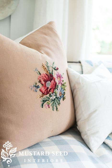 pillow made out of an unfinished, antique needlepoint
