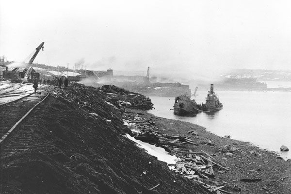 Ground zero of the Halifax Explosion. The shattered tug is the former minesweeper Stella Maris; she took the abandoned, burning Mont Blanc under tow. All but five of her crew died. (Old photo. Source).