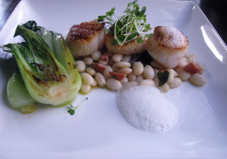 Beans with smoked ham hock, pan-seared scallops, caramelized ...