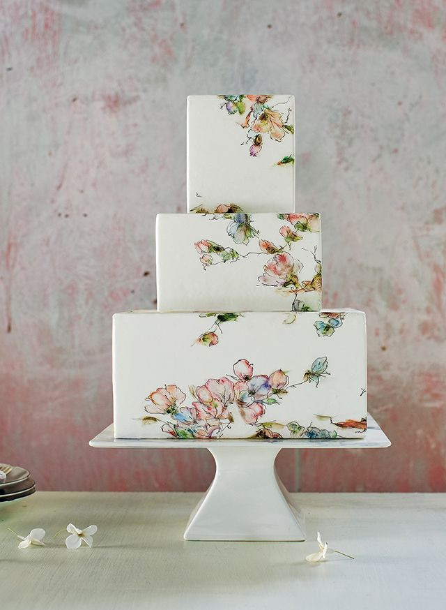 Three tier square cake with watercolor floral designs by Maggie Austin Cake. Photo by Kate Headley.