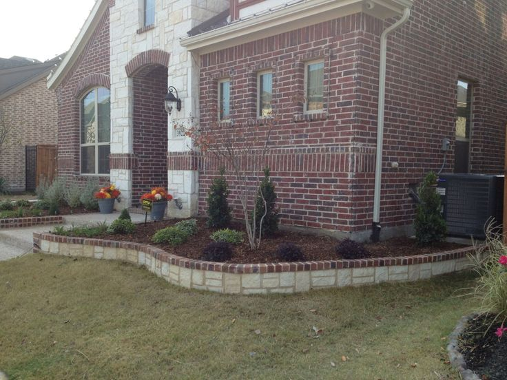 Flowerbed edging installed with white stone with a brick for Brick edging for your flower beds