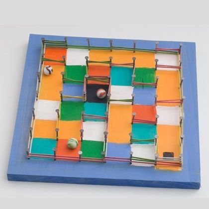Marble Maze| http://craftsinfo.net/ A changeable maze made with nails in a wooden board, and ...