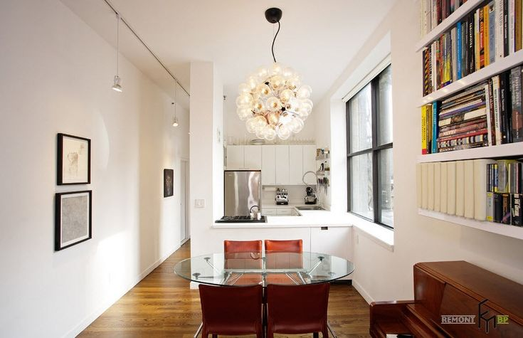 http://www.drissimm.com/wp-content/uploads/2015/07/superb-bright-colors-interior-with-modern-lighting-above-glass-dining-table-also-bookcase-idea-on-the-wall-plus-white-kitchen-cabinet.jpg