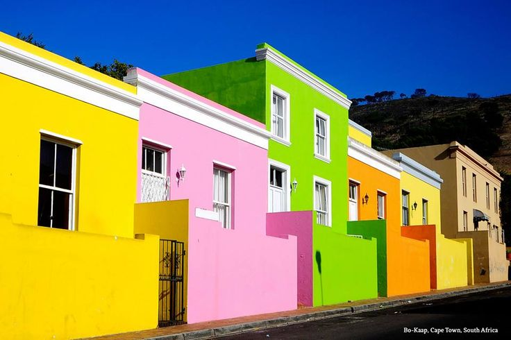 Our Colorful World: Bo-Kaap, Cape Town, South Africa  The famously multicultural area of Bo-Kaap is brightly colored with an added touch of romance from the cobble stone streets.  Looking to learn about the history of this rainbow-hued community? The Bo-Kapp Museum–housed in the oldest house in the area still in original form–is a fantastic place to visit.  If you'd rather experience some flavor to go along with the color, stop by one of the many restaurants for a traditional meal.