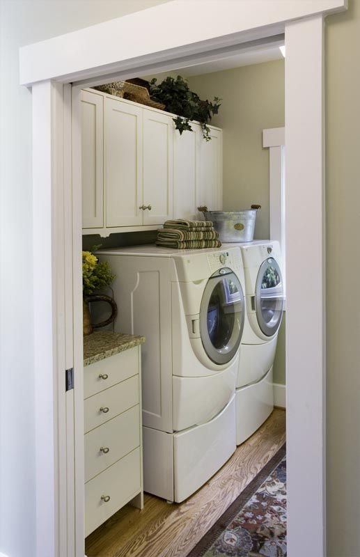 I can totally see this laundry room next to a mudroom. I love the pocket door!!! This is definitely my style. :) I'd remove the bottoms from the appliances and put a counter over them. Another long counter with a farmhouse sink on the other side. Maybe even a little flat screen tv?!