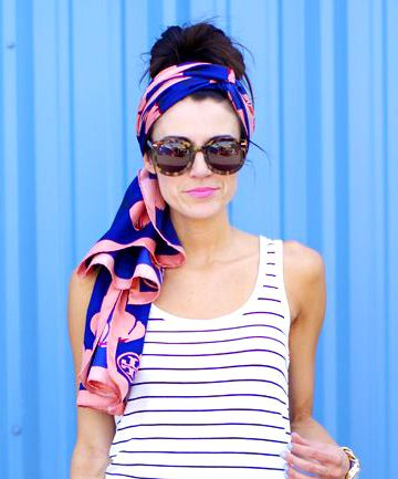 Go Bold I love the way this fashion blogger punched up a simple striped maxi dress with a neon handbag and boldly patterned Tory Burch headscarf. When you're wearing a quick no-fuss hairstyle, keep your makeup simple but impactful with a bright lip or a swipe of colored eyeliner.  To tie this headscarf simply follow the instructions here, but let the ends trail below your ponytail or bun.