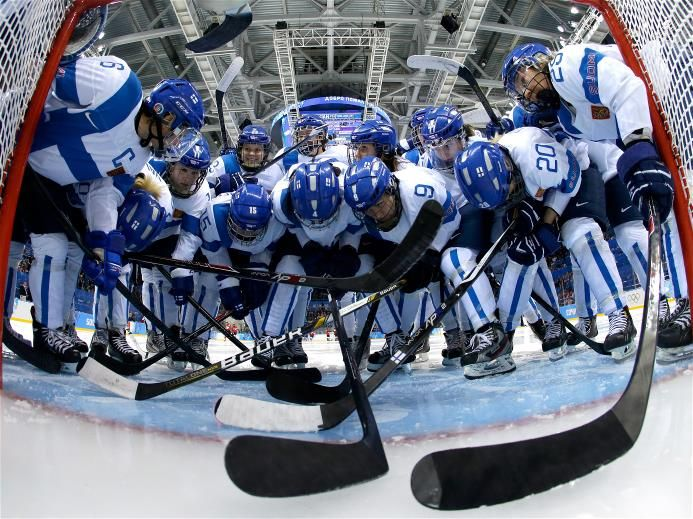 DAY 4:  Team Finland talk at the net prior to their Women's Ice Hockey Preliminary Round Group A - Canada vs. Finland
